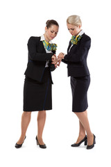 two flight attendants checking the time before the flight
