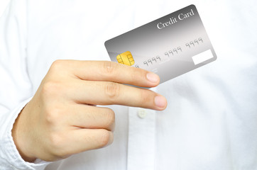 Business man 's showing the credit card
