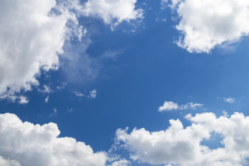 cirrus and cumulus clouds on blue sky