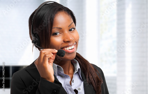 Young woman working as an helpdesk - 66214843