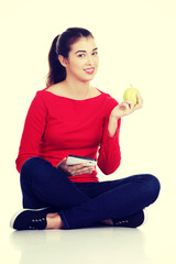 Woman with apple and tablet computer.