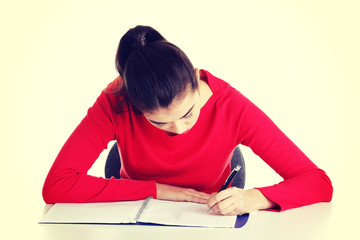 Adult student woman learnig at the desk