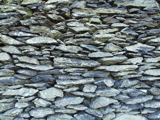 Texture of old stony wall from nature marlite material, broken
