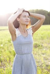 Woman in a dress standing in a field