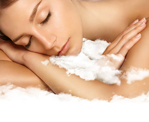 beauty woman with ideal skin sleaping on a cloud