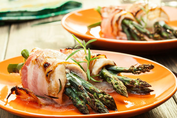 Baked asparagus wrapped in chicken and bacon