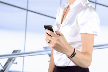 Businesswoman holding  and using the  mobile  smart  phone