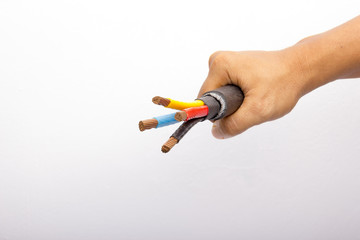 hand holding a three-phase voltage electricity cable