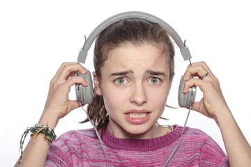 scared teenager girl with headphones,  isolated on white