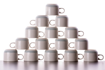 Carefully stacked pyramid of drying coffee cups