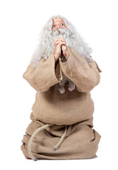 Monk prays on white background