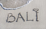 word Bali outline on the wet sand with the wave brilliance poster