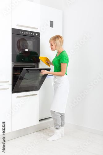 woman modern kitchen appliance setting