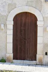 Ancient door in white brick and iron