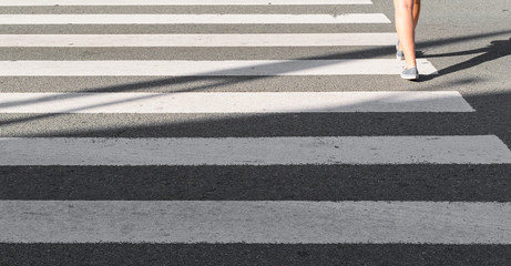 Person walking on a zebra crossing