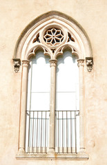 Ancient arched window with carved pedestal