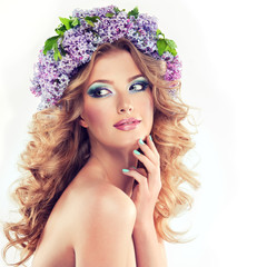 Beautiful model of flowers lilac ,with curly long hair.