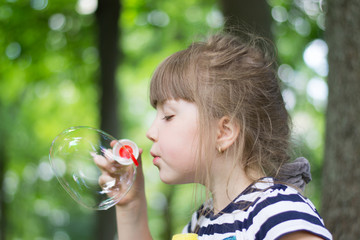girl and soap bubbles