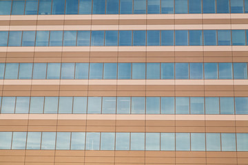 Horizontal row of office building windows in frames