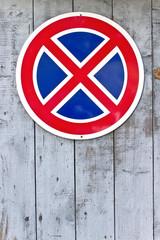 No parking traffic sign on wooden garage door