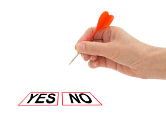 Yes no decision. Hand with dart, isolated over white.