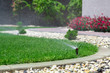 Sprinkler watering grass - 66227493
