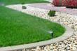 Sprinklers watering grass - 66227672