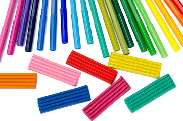 color felt-tip pens and plasticine isolated