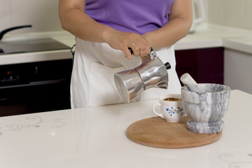 Woman pouring coffee from a percolator