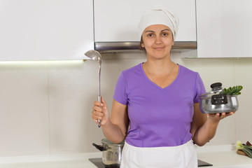 Female Cook holding pot and ladle