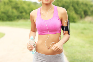 Midsection of a woman jogging in the park