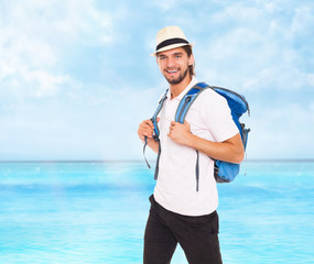 handsome man in hat with backpack, smile