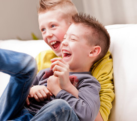 two little boys laughing