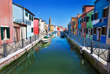 Venice, Burano island, small brightly-painted houses and channel