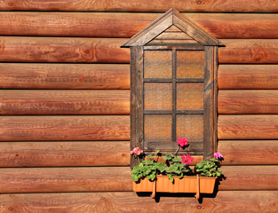 window and the wall of the log house