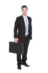 Businessman With Suitcase Over White Background