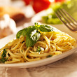 spaghetti with pesto sauce in warm light