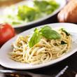 plate of italian spaghetti with pesto sauce