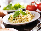 plate of italian spaghetti with pesto sauce