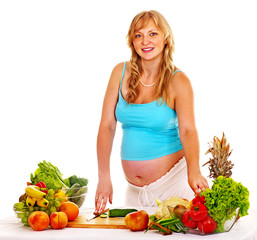 Pregnant woman preparing food .