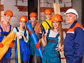 Group people in builder uniform.