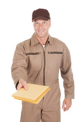 Postman Giving Envelopes Over White Background