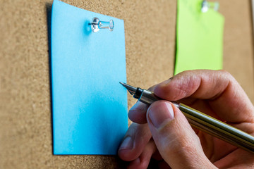 Writing on blue post it paper