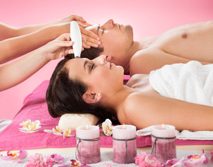 Couple Receiving Therapies At Spa