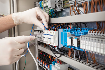 Technician Repairing Fusebox