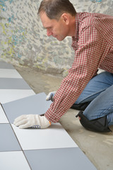 Installing ceramic tiles on a floor