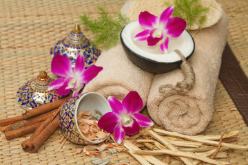 Thai spa massage setting with spa  essential oil , towel, herb ,