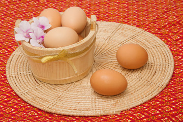 Egg collection isolated on thai fabric  background