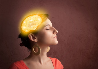 Young girl thinking with glowing brain illustration