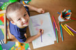 Leinwanddruck Bild - Boy, drawing a picture for fathers day